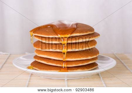 Stack Of Pancakes With Syrup Or Honey