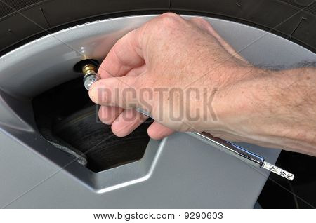 Checking The Air Pressure Of A Tire