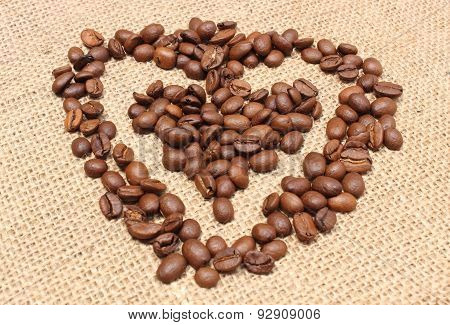 Heart Shaped Coffee Beans On Jute Background