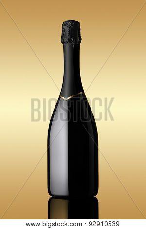 bottle Of Sparkling Wine On Gold Background