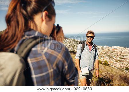 Young Woman Taking Photo For Her Boyfriend