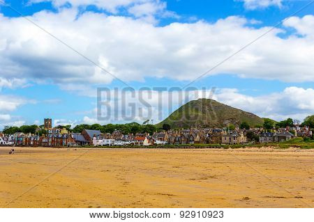 The beach in North Berwick Scotland with a view on North Berwick Law hill