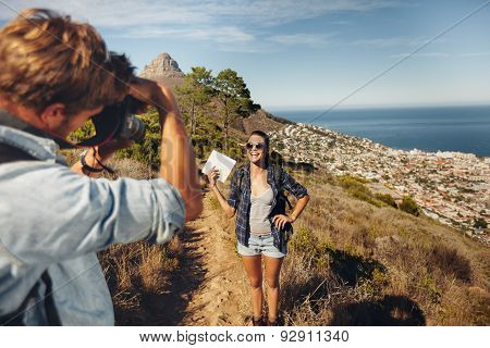 Young Couple Taking A Photo While Hiking In The Mountains