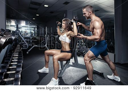 Beautiful Young Sporty Sexy Couple In Gym