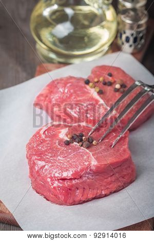 Marbled Beef Steak With A Bottle Of Olive Oil And Salt