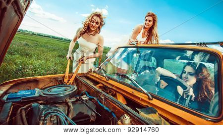 Beautiful Women With Tools Are Repairing A Car On The Rural Road