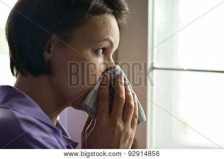 Woman feels sickness at home