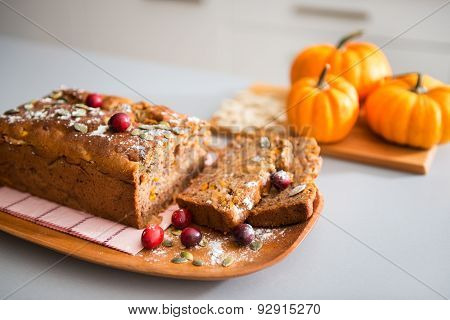 Closeup Of Home-made, Sliced Fruit And Nut Loaf And Mini Pumpkin