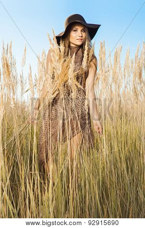 Sunrise Shot Of Young Model In Tallgrass Meadow