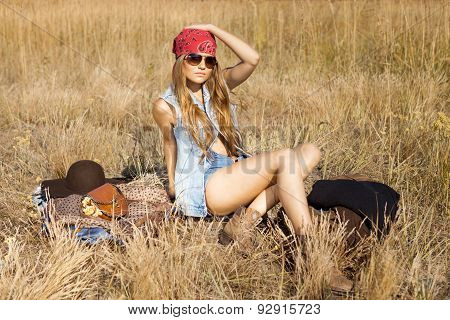 Hippie Girl Preparing To Have Picnic On A Meadow
