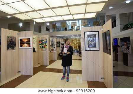 ST. PETERSBURG, RUSSIA - JUNE 7, 2015: People at first exhibition of the project