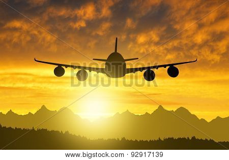 Airplane silhouette in the sunset