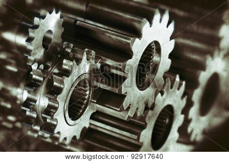 cogwheels and gears in titanium and steel, analog processing concept