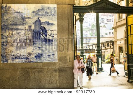 PORTO, PORTUGAL - JUNE 9, 2015: Ancient vintage azulejos picture in the old Sao Bento Railway Station of Porto. Building of Sao Bento station is a popular tourist attraction of Europe.