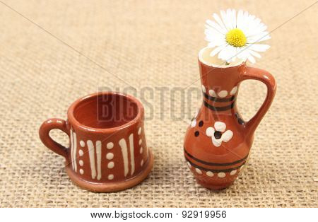 White Daisy In Brown Ceramic Vase On Jute Canvas