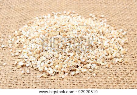 Heap Of Barley Groats On Jute Canvas