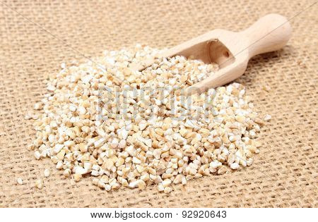 Barley Groats With Wooden Spoon On Jute Canvas
