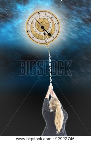 Businesswoman pulling a chain against aurora night sky in blue