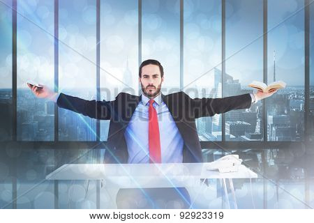 Unsmiling businessman sitting with arms outstretched against room with large window looking on city