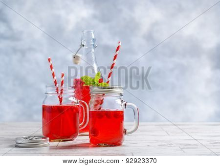 Summer raspberry fruit drinks with straws