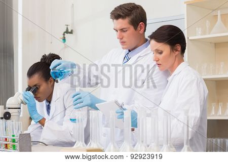 Scientists doing experimentations in the laboratory