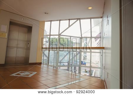 Foyer area with elevator and large window