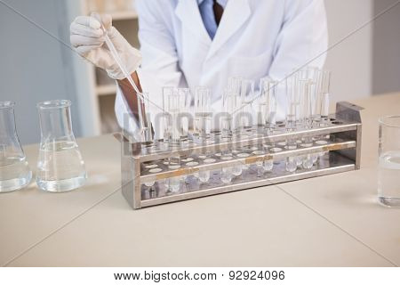 Scientist working attentively with pipette in laboratory