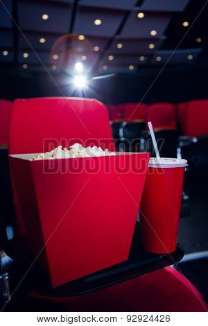 Empty rows of red seats with pop corn and drink at the cinema