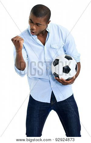 celebrating soccer fan with ball cheering in studio isolated on white