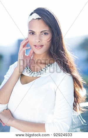 Beautiful woman well dressed looking at camera outside