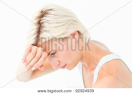 Sad woman crying with hand on forehead on white background