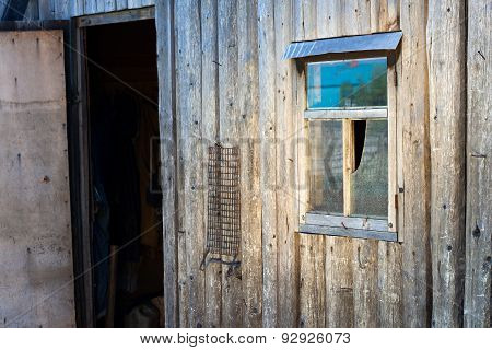 Opened Door Of A Wooden Barn