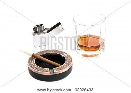 Cigarillo In Ashtray And Whiskey
