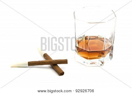 Two Cigarillos And Glass Of Cognac