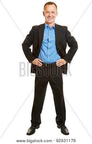Smiling full body businessman with standing his arms akimbo isolated on white