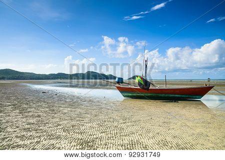 Fishing Boat On Wavy Sand Beach