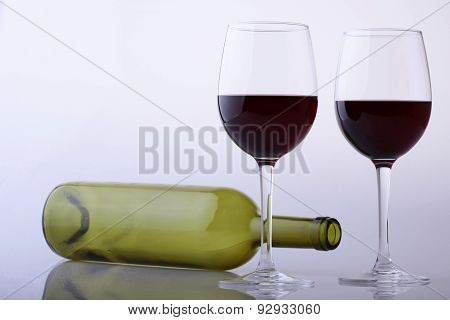 Empty Bottle And Glasses Of Red Wine