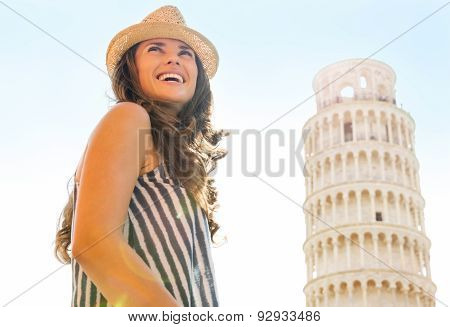 Happy Woman Tourist At Leaning Tower Of Pisa