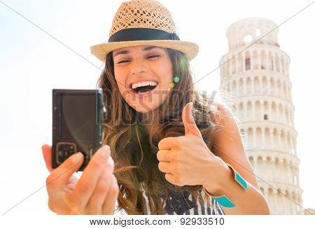 Happy Woman Tourist Giving Thumbs Up Taking Selfie In Pisa