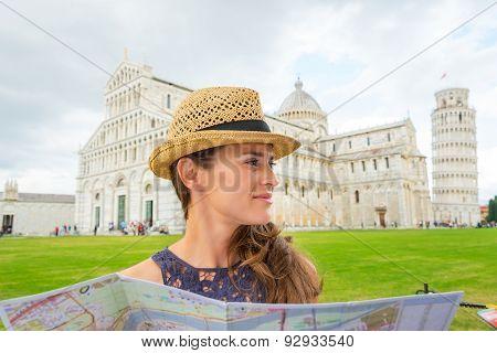 Woman Wearing Hat In Profile Holding Map In Pisa