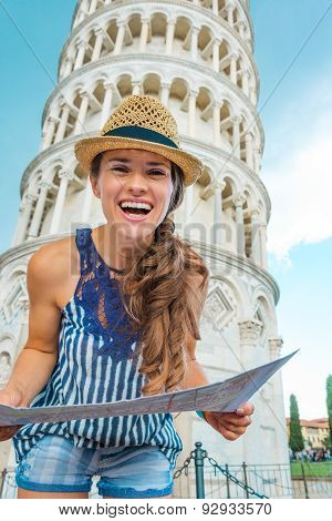 Smiling Woman Tourist Holding Map In Front Of Tower Of Pisa