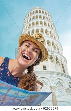Closeup Of Laughing Female Tourist Holding Map In Pisa