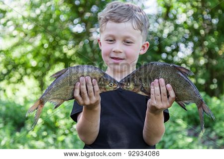 Boy Holds Two Fish Bream