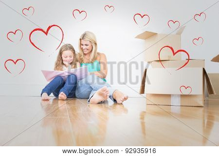 Mother and daughter reading a book against red hearts