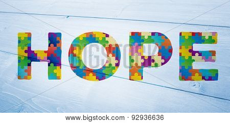 Autism message of hope against bleached wooden planks background