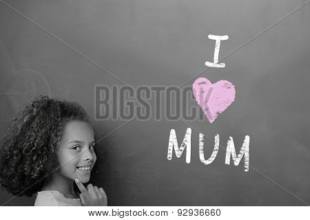 Mothers day greeting against schoolchild with blackboard