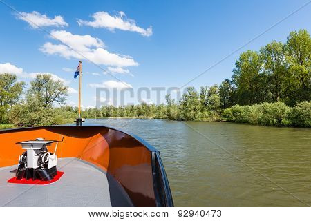 Backside Of A Boat Sailing In A Nature Reserve