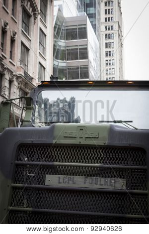 NEW YORK - MAY 21 2015: Reflection of a city building on the windshield of a military vehicle parked on the street on display for the public at Bryant Park for Marine Day during Fleet Week NY.