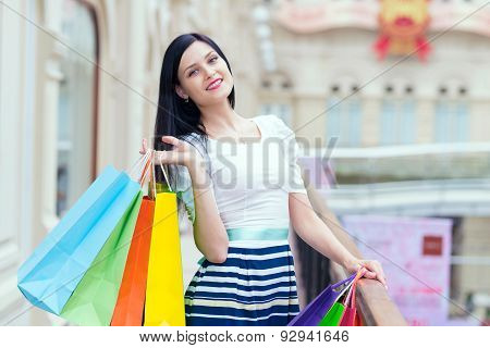 Beautiful Smiling Young Woman With The Colourful Shopping Bags From The Fancy Shops.