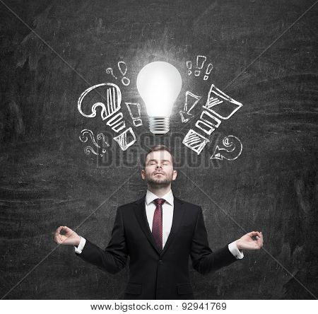 Mediating Businessman Is Brainstorming The Business Problems. Turned Lightbulb And Question And Excl